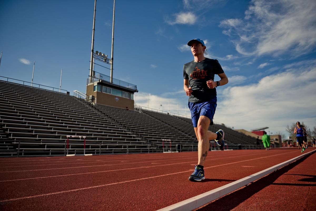 Mario Fraioli running on a track